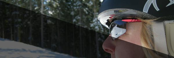 woman wearing polarized sunglasses on the ski slopes