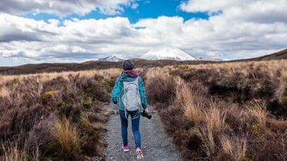 Hiker in Pugs Apparel Walking on Trail