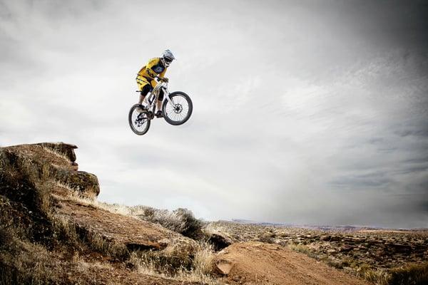 Mountain Biker Wearing Pugs Apparel in Mid Air