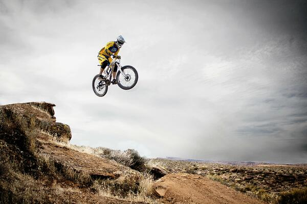 Mountain Biker Wearing Pugs Apparel in Mid Air
